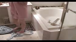 She masturbates with jet his bathtub.