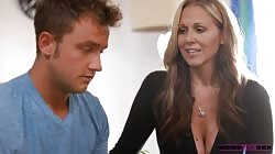 Big-breasted mommy jerking youngster's dick with pleasure