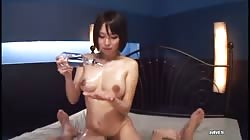 Oiled Asian masseuse is providing amazing service for her client