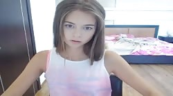 Innocent 18 yo beauty is playing with her small boobies