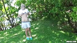 Watch how a stunning blondy plays with her clit outdoors