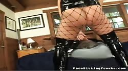 Big-breasted domina posing and smother her slave's face