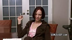 Dark-haired milf girlfriend is smokes loocking into camera