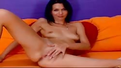 Smoking hot brunette poses naked and masturbates on the webcam