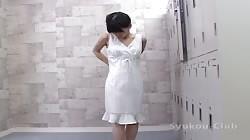 Beauty in white lingerie is demonstrating her shape in the locker room
