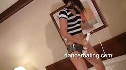 Young Dancerbating model dances and plays with a vibrator