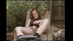 Teen masturbating at home in the back yard