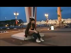 Brunette flash and masturbate on a big traffic roundabout