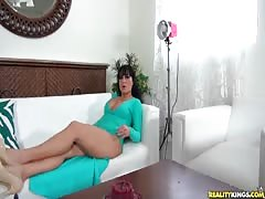 Impressive milf is slowly undressing and playing with her snatch