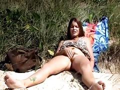 Young girl masturbating on the beach