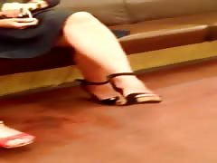 Candid cross legs in sexy high heels