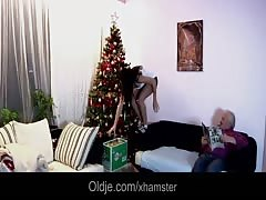 Oldman fucks jolly young brunette while decorating Xmas tree