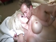 Fake-tit blondy jumping on a huge man meat in Porn constancy movie