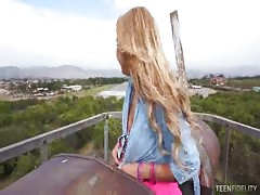 Tanned blonde is sucking hard dick of her friend outdoor on cam