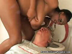Sexy busty ebony is smothering her slave in the toilet