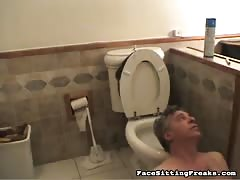 Glamour blonde sit on her slave's face in the toilet