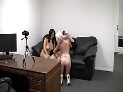 Busty blonde and brunette are sucking interviewer's dick together