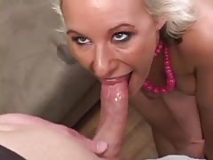 Platinum blonde beauty deep throats a hard cock then gets fucked