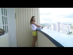 teenage  coupele screw on the balcony