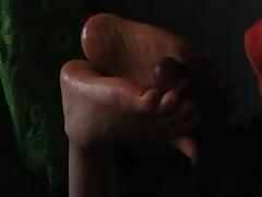 Preparing her beautiful amateur feet for foot job