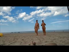 two  damsels  in full-frontal nudity on the beach