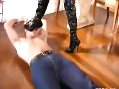 Man gets dominated by tranny in boots