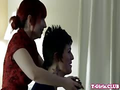 Inked transgirl straponfucked by redhead babe