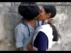 Indian school girl with hot kiss in outdoor