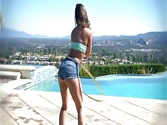 Remy Lacroix oils up her juicy ass for rough anal by the pool