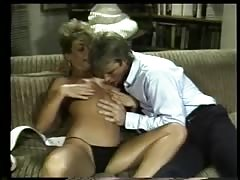 Blonde beauty deep throats a hard cock on the couch