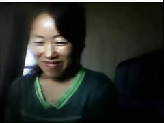 Chinese girl flashes tits when husband is away