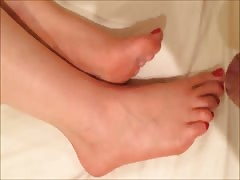 Footjob cum on girlfriends sexy bare feet with red pedicure