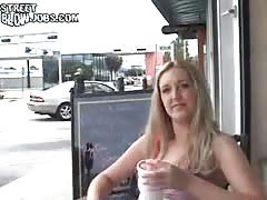 Smiling blonde performs a perfect street blowjob without being shy