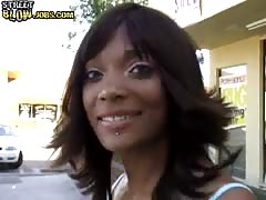 Young ebony is giving a really nice interracial street blowjob
