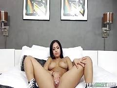 Amazingly busty brunette Karissa Kane rubs her lovely pussy