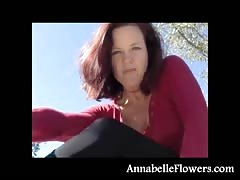 Awesome redhead milf Annabelle Flowers is taking off her socks outdoors