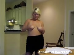 Awesome busty milf Annabelle Flowers is playing with her huge boobs