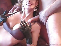 Lusty glamorous milf Shanda Fay is lying on the bed and sucking a dick