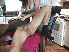 Brunette is kneeling customary and starting to slurp  her hubby's butt hole