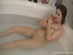 scrumptious brunette female washes her curvaceous bod