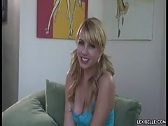 Pigtailed blonde Lexi Belle is blowing a blue dildo