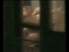 Couple caught through a window on spy cam