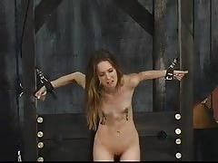 Cute young long hair brunette is ball gagged and restrained for spanking