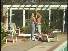 Young cute blonde whore deep throats a hard cock in front of pool