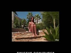Hot brunette teen oils her tits then fucks her pussy outdoors