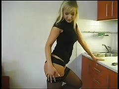 blonde girlfriend in the kitchen stripping