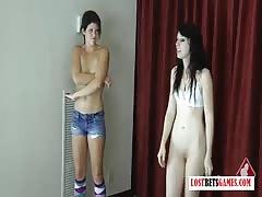 2 cute girls play an intense game of strip darts